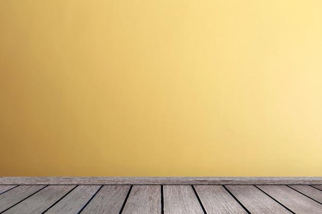コピースペースを持つ黄色の色調の壁インテリア寄木細工の床のリビングルーム