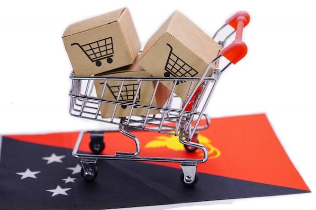 ショッピングカートのロゴとパプアニューギニアの旗の箱。