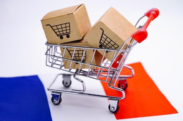 ショッピングカートのロゴとフランスの国旗が付いている箱