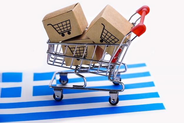 ショッピングカートのロゴとギリシャの国旗が付いている箱。