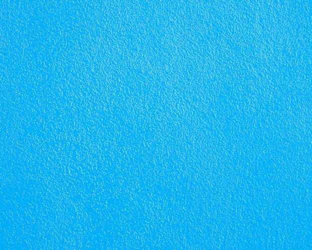 背景の青いセメントまたはコンクリートの壁のテクスチャです。
