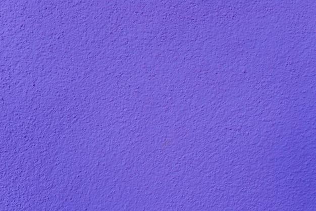 紫色のセメントまたはコンクリートの壁のテクスチャの背景