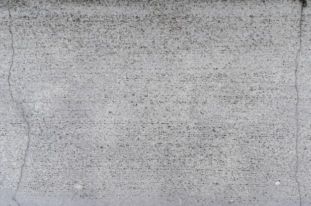 亀裂テクスチャ背景を持つ灰色のコンクリート