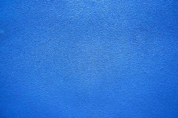 青い海色のコンクリートの壁のテクスチャの背景を描いた