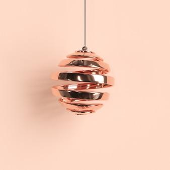 パステル調の背景にバラの金の装飾品クリスマスボール。最小限のクリスマスコンセプトのアイデア。