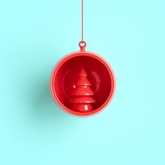 赤い木の飾りパステル調の背景にクリスマスボール。最小限のクリスマスコンセプトのアイデア。