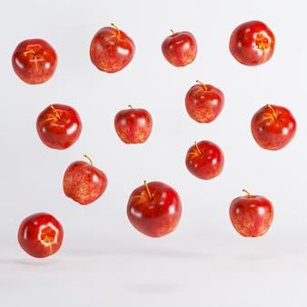 白い背景の上に浮かぶ赤いリンゴ。最小限のアイデア食品のコンセプトです。