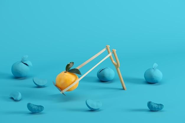 Выдающийся мандарин в рогатке в окружении на синем фоне