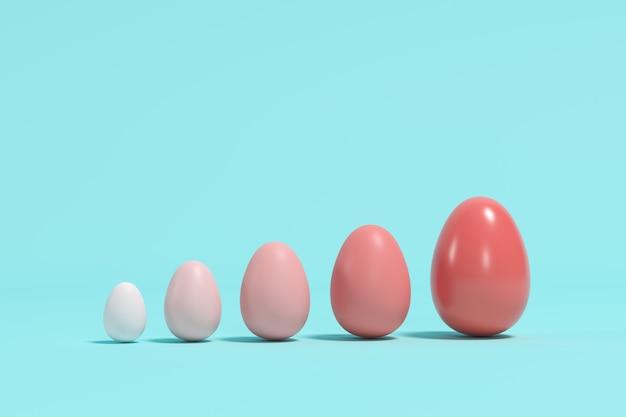 青色の背景にさまざまなサイズの赤い単調卵。最小限のイースターの考え。