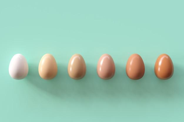 緑色の背景で卵のさまざまな色合い。最小限のイースターの考え。