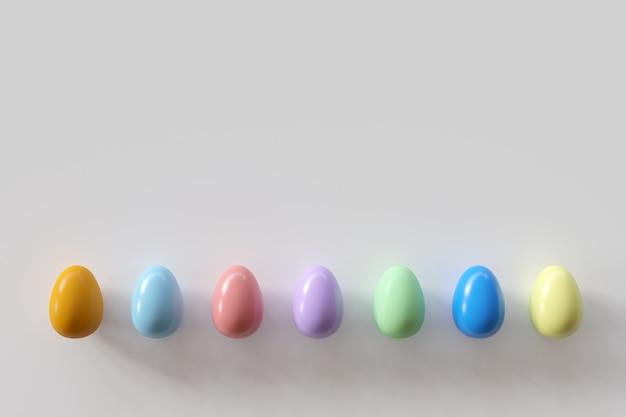 白地にカラフルな卵。最小限のイースターの考え。
