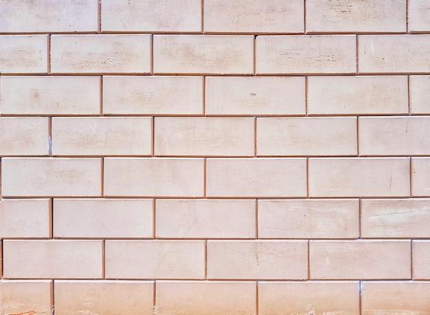 ヴィンテージコンクリートのレンガの壁面の背景とテクスチャのフルフレーム。