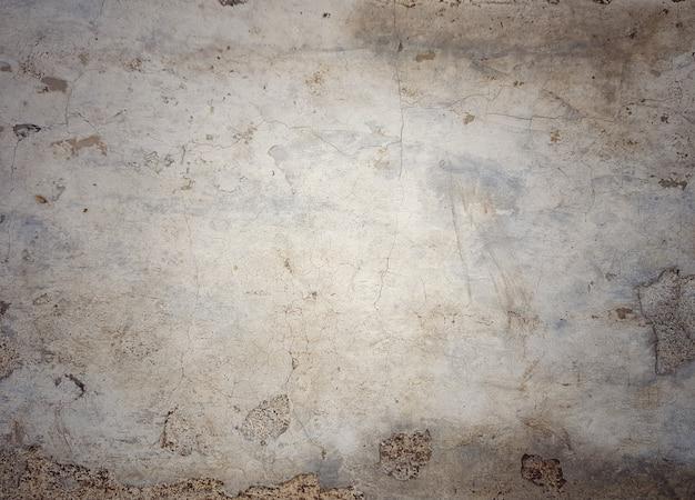 背景の材料のためのひび割れたヴィンテージレトロコンクリート壁のフルフレーム