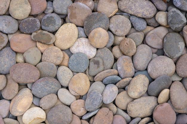 丸い小石の背景テクスチャのビュー。