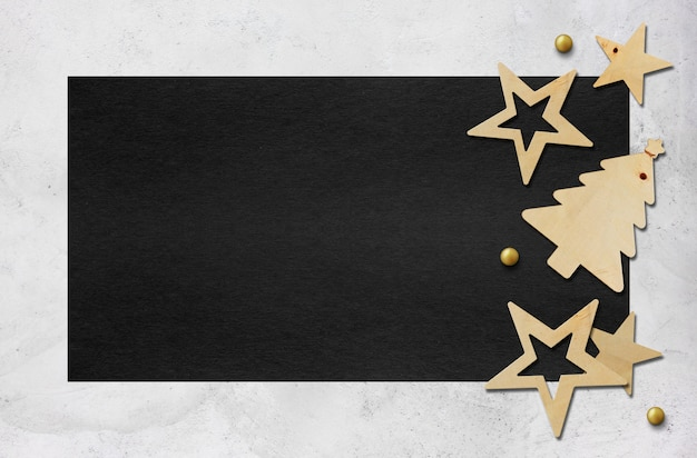 黒い紙の背景にクリスマスの装飾