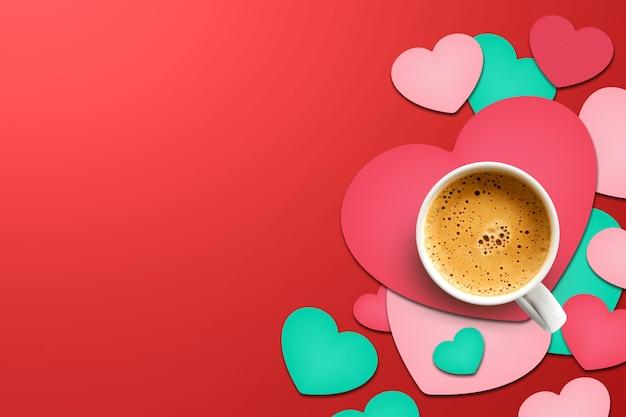 幸せなバレンタインデーのコンセプト。ハート形の紙の上のコーヒーカップ