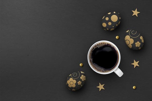 Пасхальные яйца и чашка горячего кофе на черном фоне бумаги. вид сверху