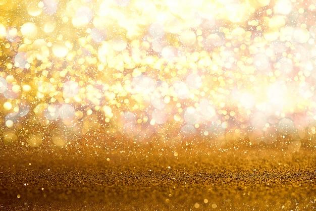Блеск золото старинные огни текстуры фона. расфокусированный