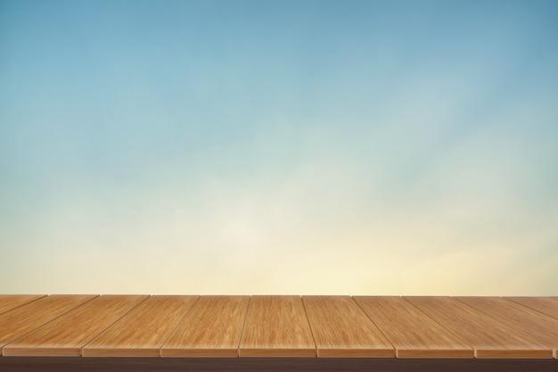 ビューの青い背景を持つ木製テーブル。ディスプレイ製品に使用できます。