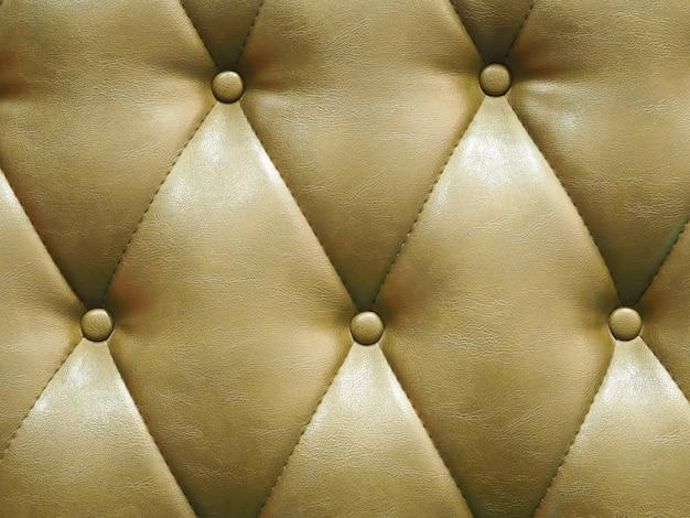 茶色の革ヴィンテージソファクッション背景。