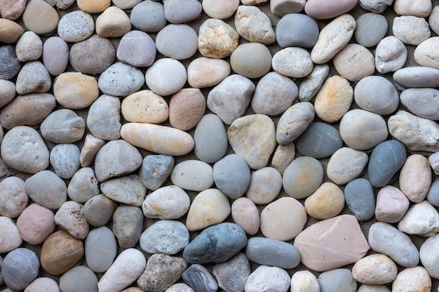 青と灰色の海の小石石の壁のテクスチャ背景。