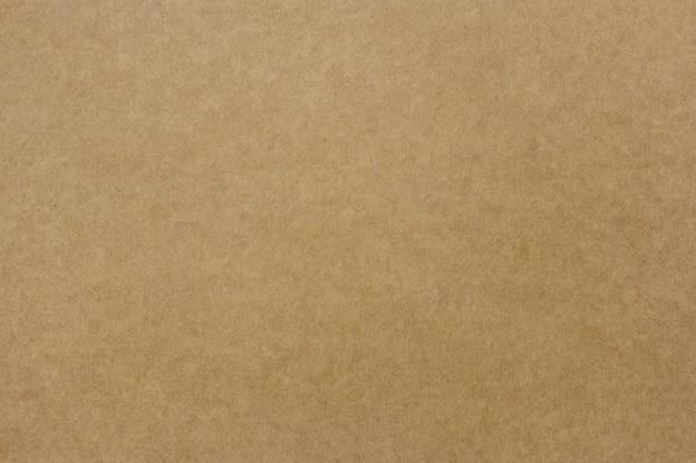 Конец вверх по коричневому цвету рециркулирует бумажную пользу текстуры для дизайна предпосылки.