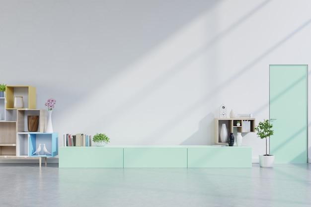 緑のキャビネットとリビングルームのテレビの壁、白い壁。