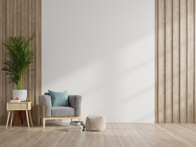インテリアには、空の白い壁の背景に肘掛け椅子があります。