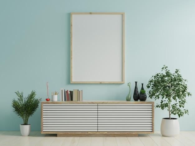 インテリア/青い壁のキャビネットのポスターフレームのモックアップ。