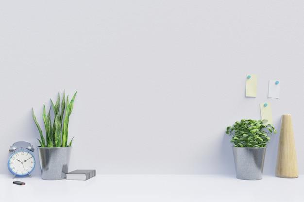 Современное рабочее место с креативным столом с растениями имеет белую стену