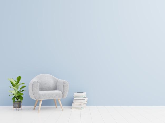 青い壁の背景に本とベルベットの肘掛け椅子付きのリビングルームのインテリア。