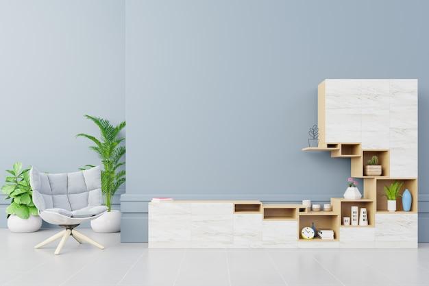青い壁の背景にモダンなリビングルームのアームチェア付きのキャビネットテレビ