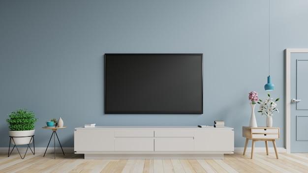 空白の画面がぶら下がっているキャビネットのスマートテレビモックアップは植物があります。