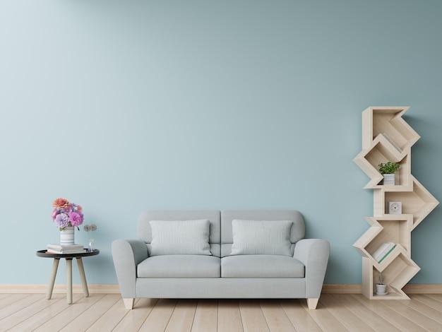 リビングルームの本棚にはソファと水色の壁があります