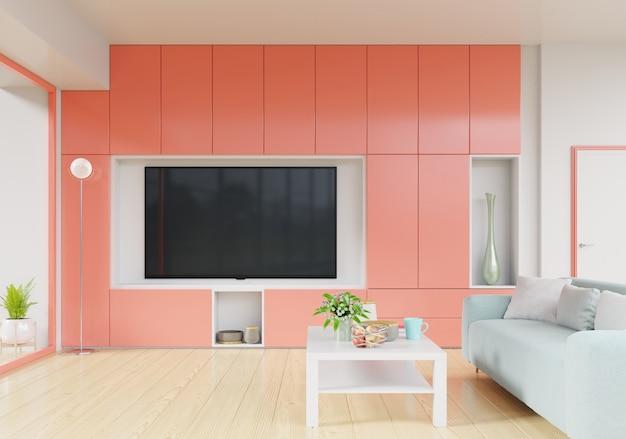 Телевизор на подставке в современной гостиной с диваном, столом, цветами и растениями