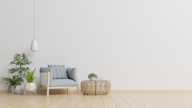 インテリアには、空の白い壁の背景にアームチェアがあります。
