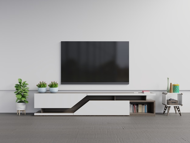 植物のあるモダンなリビングルームのキャビネットのテレビ