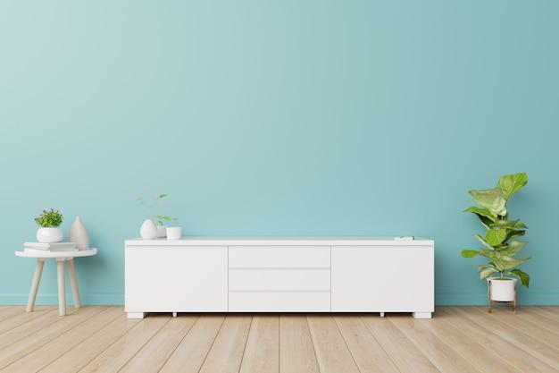 Шкафы для телевизора в комнате, голубые стены.