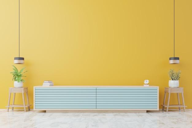 Шкафчик для телевизора или место объекта в современной гостиной с лампой, столом, цветком и растением на желтой стене.