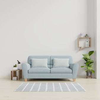 ソファと緑の植物、ランプ、白い壁の背景にテーブルとモダンなリビングルームのインテリア。