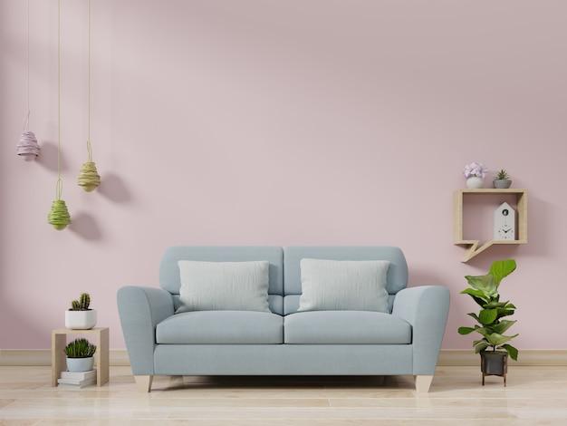 Современный интерьер гостиной с диваном и зелеными растениями, лампа, стол на розовой стене