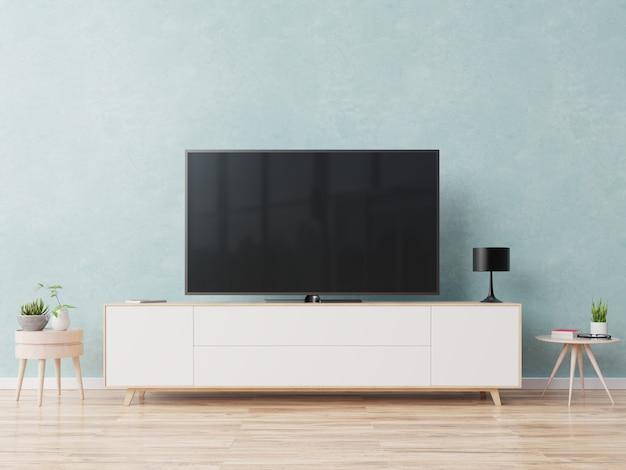 青い壁の背景にモダンなリビングルームのキャビネットのテレビ。