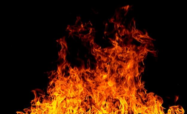 火災のテクスチャは、黒の背景には、飛ぶ火の火花