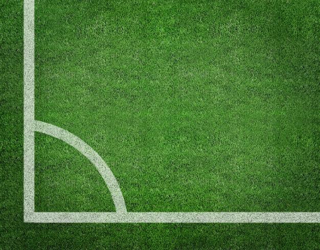 トップビューから緑のサッカーフィールドに白いストライプ