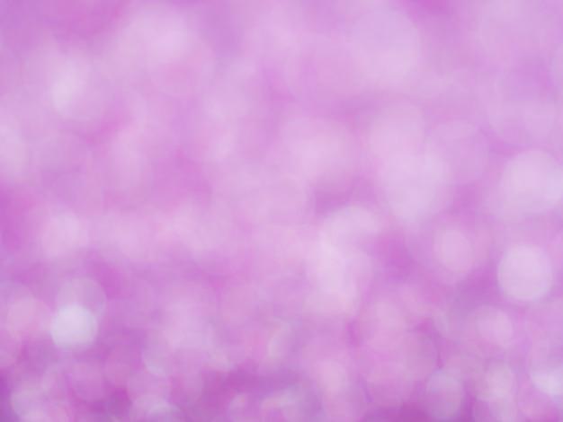 ボケと紫の抽象的な輝きの背景。ロマンスバクのためにぼんやりとした柔らかいピンク