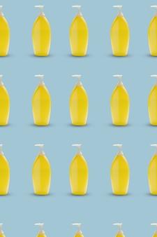 青色の背景にポンプボトルの黄色の色のパターン