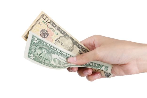白で隔離される支払うドルのお金を持つ女性の手