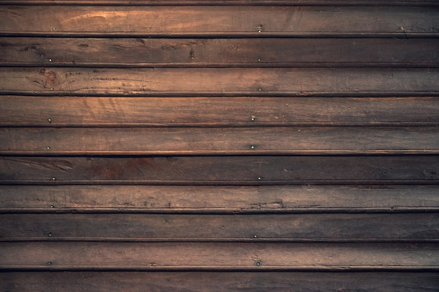 木のテクスチャの背景のための古い伝統家の暗い茶色の板の板