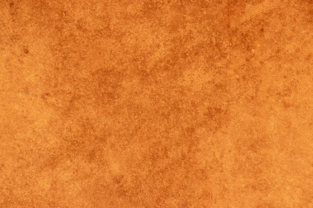 牛の皮から作られた古いドラムの茶色の革の質感のクローズアップ