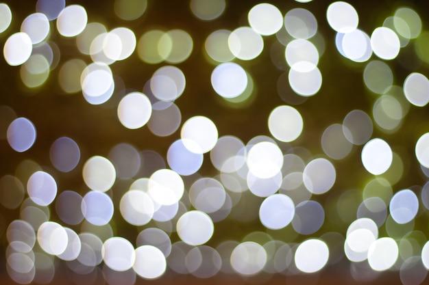 光の抽象的な背景のカラフルな円